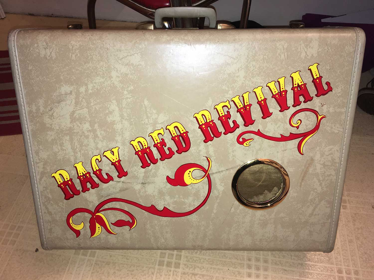 Lettering and pinstriping by Julie Fournier on a Vintage Suitcase turned into a speaker for the band Racy Red Revival